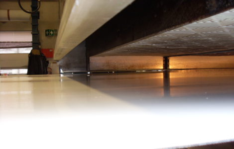 Laminate of synthetic (plastic) conveyor belts